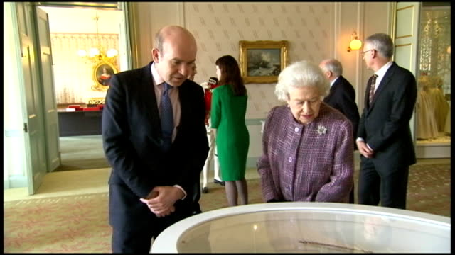 the queen and prince philip visit the newly renovated kensington palace various of queen elizabeth looking at historiacal costumes on display in... - kensington palace video stock e b–roll