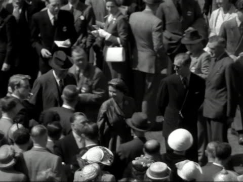 the queen and prince philip walk through the crowds at goodwood race course - goodwood house stock videos & royalty-free footage