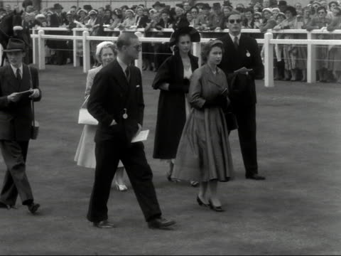 the queen and prince philip walk through the paddock at goodwood race course - goodwood house stock videos & royalty-free footage