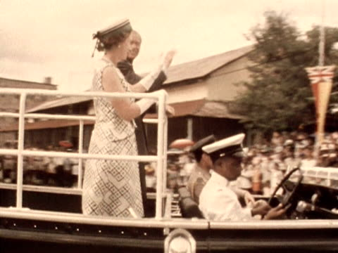 The Queen and Prince Philip wave to the crowds from the back of a jeep during their tour of Mahe 1972