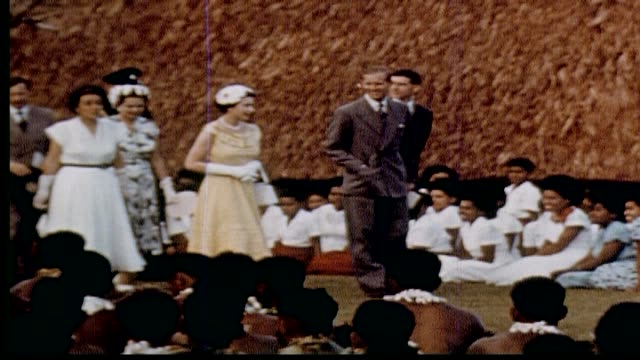 the queen and prince phillip visit a school, speak with officials. - königin stock-videos und b-roll-filmmaterial