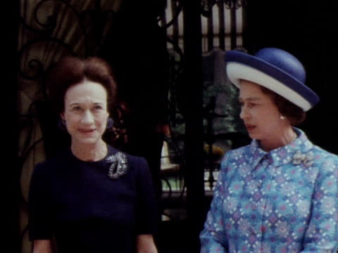 the queen and the duchess of windsor pose for photographs following the queen's visit to the windsors home in paris 1972 - windsor england stock videos and b-roll footage