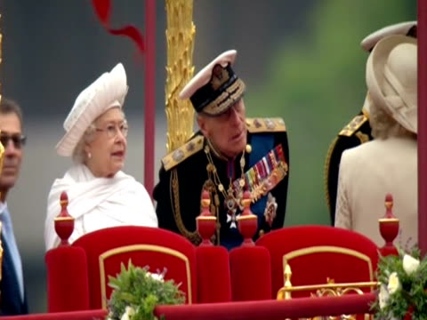the queen and the duke of edinburgh aboard the royal barge 'gloriana' during the diamond jubilee celebrations - barge stock videos & royalty-free footage