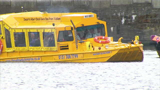the queen and the duke of edinburgh have ridden a yellow duckmarine on the river mersey as part of the diamond jubilee tour on merseyside exterior... - boat ramp stock videos & royalty-free footage