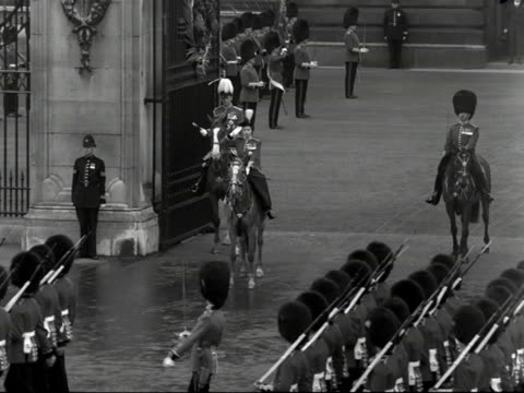 the queen and the duke of edinburgh on horseback watch the grenadier guards march past buckingham palace during the trooping the colour ceremony.... - recreational horse riding stock videos & royalty-free footage