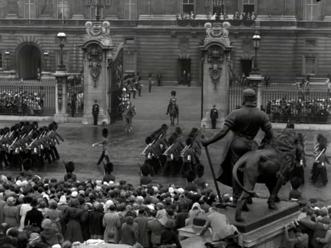 the queen and the duke of edinburgh on horseback watch the grenadier guards march past buckingham palace during the trooping the colour ceremony 1953 - field marshal stock videos and b-roll footage