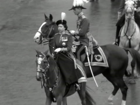 the queen and the duke of edinburgh wearing military uniforms riding along the mall during the trooping of the colour ceremony 1953 - field marshal stock videos and b-roll footage