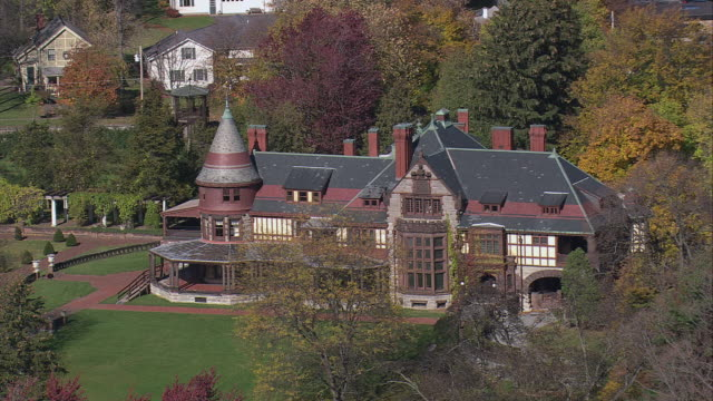 AERIAL The Queen Anne style Sonnenberg mansion and its surrounding grounds / Canandaigua, New York, United States