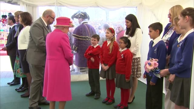 'the queen at 90' queen opens alexandra gardens bandstand int queen greeting school children / queen given posey of flowers - bandstand stock videos and b-roll footage