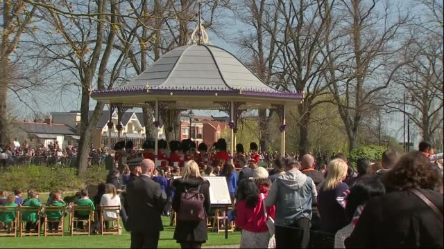 'the queen at 90' queen opens alexandra gardens bandstand **music heard intermittently sot** bandstand and band playing sot / school children along... - bandstand stock videos and b-roll footage
