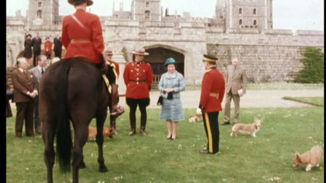 'The Queen at 90' The Queen's love of corgis FS150577001 / 1551977 Windsor Windsor Castle Queen being presented with horse by the Royal Canadian...