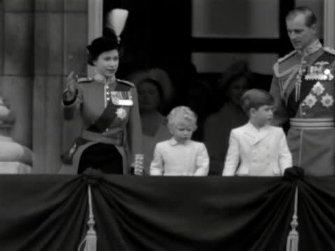 The Queen Duke of Edinburgh Prince Charles and Princess Anne walk out onto the balcony of Buckingham Palace and wave to the crowds during the...