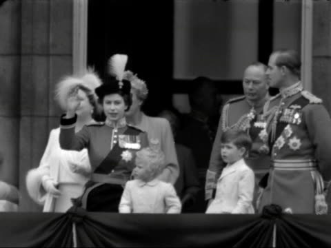 The Queen Duke of Edinburgh Prince Charles Princess Anne and the Queen Mother on the balcony of Buckingham Palace waving to the crowds during the...