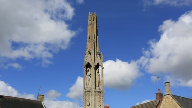 The Queen Eleanor Cross in the village of Geddington, Northamptonshire, England.