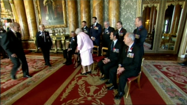 the queen hosts reception for the victoria cross and george cross association england london buckingham palace int military veterans and current... - the victoria cross stock-videos und b-roll-filmmaterial