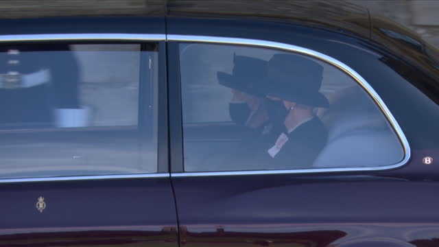 the queen, in the state bentley and accompanied by her lady in waiting, arrives to join the funeral cortege for her husband prince philip, duke of... - mourning stock videos & royalty-free footage