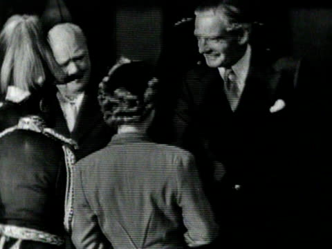 The Queen introduces Haile Selassie to Winston Churchill Anthony Eden the Mayor of London and other official dignitaries at Victoria Station at the...