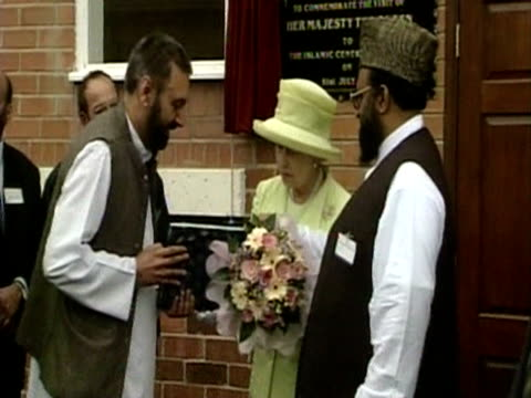 The Queen is presented with a copy of the Koran during her visit of Scunthorpe's mosque as part of her Golden Jubiliee tour