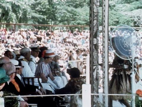 vídeos y material grabado en eventos de stock de the queen is presented with and drinks a cup of kava during a traditional fijian welcoming ceremony during the start of her silver jubilee tour of... - plataforma de construcción