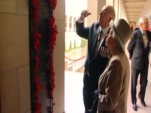 The Queen is shown the plinth in the War Memorial which records Australia's loss in Afghanistan