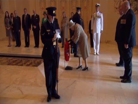 stockvideo's en b-roll-footage met the queen lays a wreath at the tomb of the unknown soldier in the war memorial, canberra - memorial