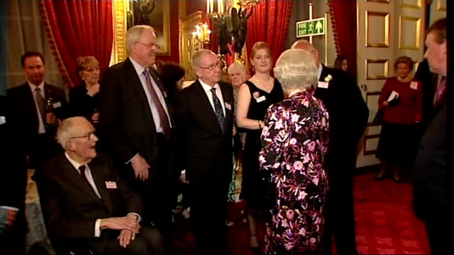 the queen meets with business leaders at charity event; queen elizabeth along greeting guests at retail trust birthday anniversary event as prince... - queen's birthday stock videos & royalty-free footage