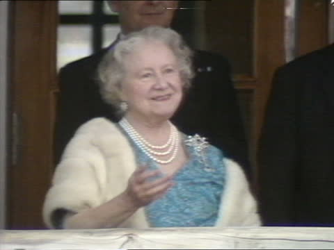'the queen mother at 85': a birthday portrait special:; england: devon: plymouth: queen mother stirring cake for new aircraft carrier hms ark royal... - waterfront stock videos & royalty-free footage