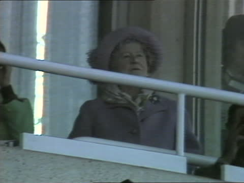 'the queen mother at 85': a birthday portrait special:; england: sandown races : cms queen elizabeth the queen mother watching, lifts binoculars and... - optical equipment stock videos & royalty-free footage