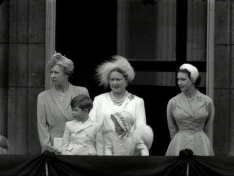 stockvideo's en b-roll-footage met the queen mother princess margaret and a young prince charles and princess anne watch the trooping of the colour ceremony from the balcony on... - prinses margaret windsor gravin van snowdon
