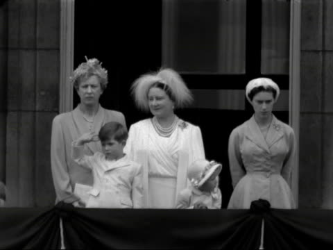 The Queen Mother Princess Margaret and a young Prince Charles and Princess Anne watch the Trooping of the Colour ceremony from the balcony on...