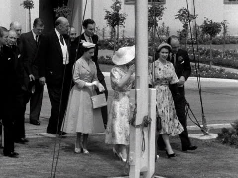the queen mother princess margaret the queen and prince philip walk across the airfield at london airport 1953 - sun hat stock videos & royalty-free footage