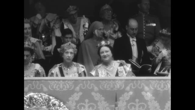 the queen mother smiles and chats with family members at queen elizabeth's coronation ceremony in 1953 includes princess mary pictured to the queen... - coronation of queen elizabeth ii stock videos and b-roll footage