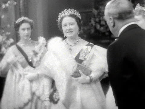 the queen mother talks to various dignitaries at the royal opera house for the gala premiere of benjamin britten's new opera gloriana 1953 - crown headwear stock videos and b-roll footage