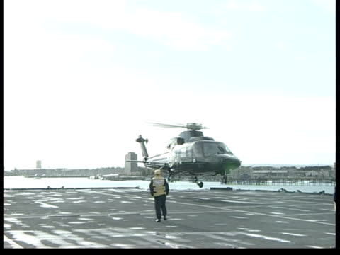 the queen mother visits hms ark royal england hampshire portsmouth queen mother's helicopter landing on flight deck ms queen mother slowly along deck... - hydraulic platform stock videos & royalty-free footage