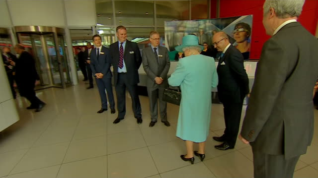 the queen officially opens the new bbc broadcasting house ext bbc broadcasting house car arriving / royal standard flag on top of building / the... - limousine stock-videos und b-roll-filmmaterial