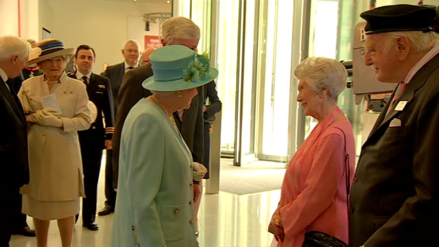 the queen officially opens the new bbc broadcasting house newroom studio with news presenters looking out at the queen surrounded by staff and... - david dimbleby stock videos & royalty-free footage