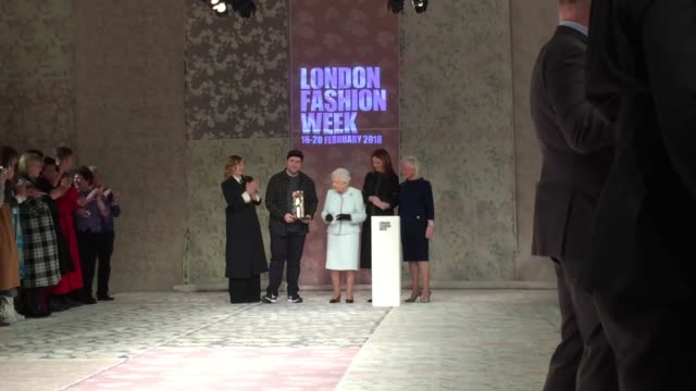 the queen presents an award to richard quinn at london fashion week at bfc show space on february 20 2018 in london england - modewoche stock-videos und b-roll-filmmaterial