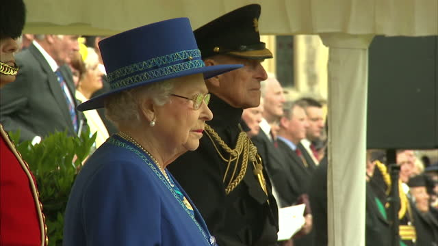 The Queen presents new colours to the Welsh Guards Shows exterior shots the Queen watching as Welsh Guards walk off the quadrangle at Windsor Castle...