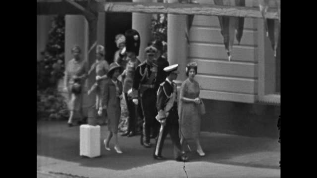 the queen prince philip king bhumibol and queen srinagarindra board carriages at victoria station - king of thailand stock videos and b-roll footage