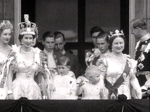 the queen, prince philip, prince charles and princess anne wave to the crowds from the balcony of buckingham palace, as the queen mother, princess... - crown headwear stock videos & royalty-free footage