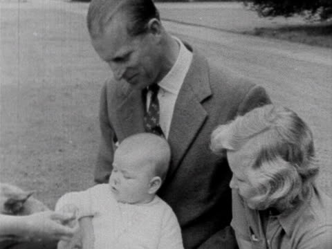 The Queen Prince Philip Prince Charles Princess Anne and a baby Prince Andrew sit on a rug in the Balmoral grounds 1960