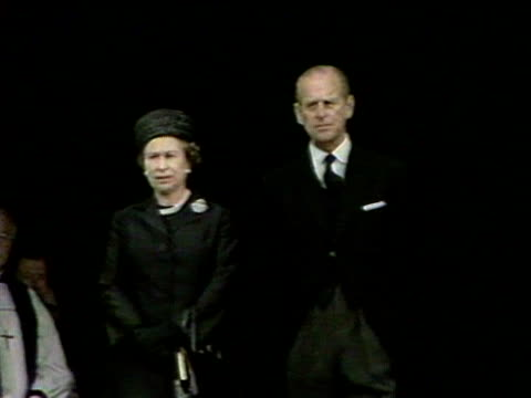 the queen, prince philip, the queen mother and princess anne stand outside st george's chapel following the funeral of the duchess of windsor. 1986. - イングランド南東部点の映像素材/bロール