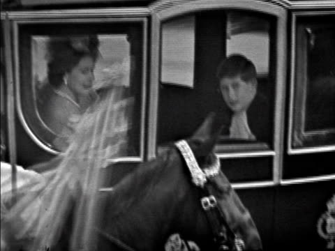 vídeos de stock, filmes e b-roll de the queen queen mother and prince charles ride in a royal coach on the wedding day of princess margaret 1960 - 1960
