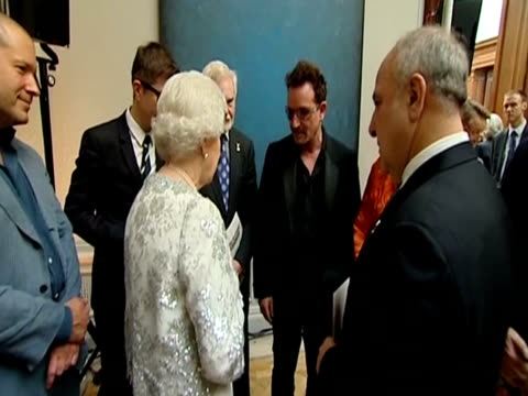 The Queen talks to Bono Sir Derek Jacobi and Gareth Malone at a Diamond Jubilee event at the Royal Academy