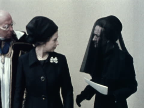 the queen talks to the duchess of windsor following the funeral service for the duke of windsor at st george's chapel - funeral stock videos & royalty-free footage