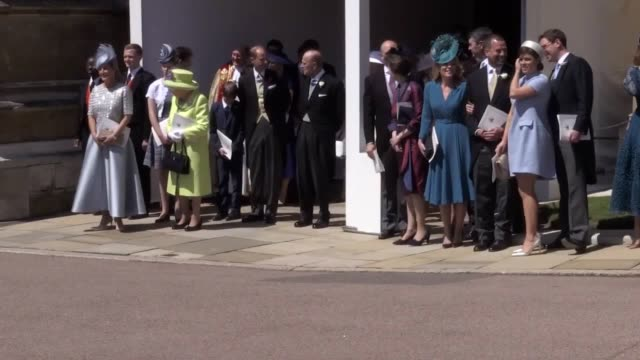 the queen the duke of edinbrugh and other members of the royal family observe the departure of prince harry and meghan from st george's chapel windsor - st. george's chapel stock videos and b-roll footage