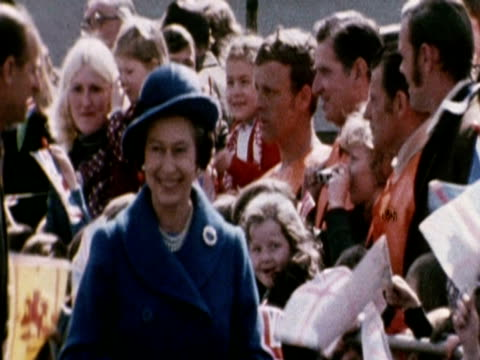 the queen walks along govan walkway and receives a bouquet from a girl during her silver jubilee tour - glasgow scotland stock videos & royalty-free footage