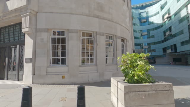 the quiet pavement outside the bbc's broadcasting house on april 24, 2020 in london, england. the uk remains in full lockdown due to the coronavirus... - bbc stock videos & royalty-free footage