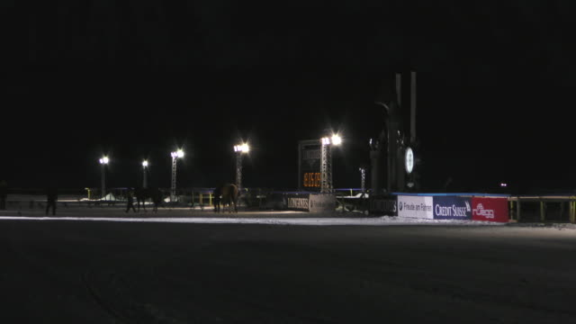 the racetrack on the frozen lake of st moritz for the spectacular nighttime horse races that take place on february 5th 2016 in st moritz - nordic skiing event stock videos and b-roll footage