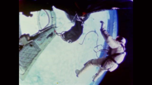 the radio chatters as an astronaut conducts repairs during a spacewalk - spacewalk stock videos & royalty-free footage